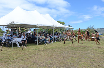 Rapa Nui dance show in front of lunching tourists in tent