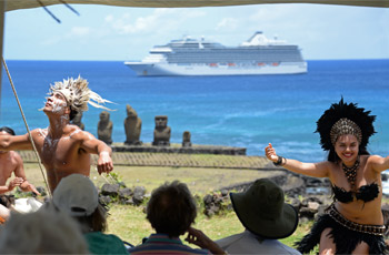 Rapa Nui girl dancing with man in tahai, cruise ship in blue ocean and moai statues