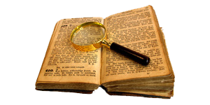 Old book with magnifying glass