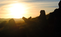 Silhouette of moai statues at sunset in volcano quarry and statue factory Rano Raraku