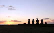 Sunset at Tahai with moai statues silhouette