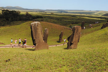 Tourists taking photos of Easter Island heads.