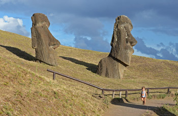 Young boy walking in Rano Raraku moai statue factory at Easter Island