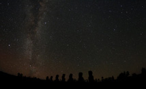 Starry sky above Ahu Akivi with Milky Way visible at Rapa Nui (Easter Island)