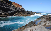 Colorful ocean and rocks with curves in Vinapu area, Easter Island (Rapa Nui)