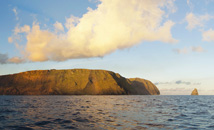 Easter Island and Motu Kao-Kao from ocean by sunset