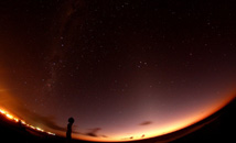 Wide shot of starry sky above Hanga Roa and Tahai Milky Way at Rapa Nui (Easter Island)