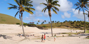 Anakena beach with palm trees and moai statues