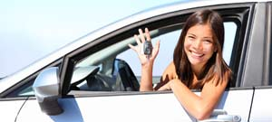 Woman with keys car hire rental