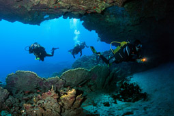 Scuba diving in underwater cave with flashlight.jpg