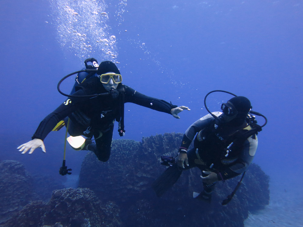 Scuba diving novice with instructor