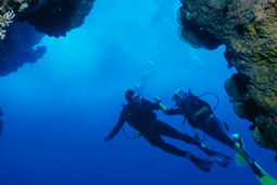 Scuba diving by Easter Island rock formations.jpg
