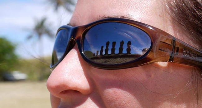 Sunglasses reflection of moai statues at Anakena